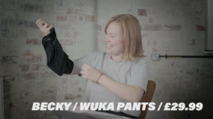 young woman holding up reusable period pants